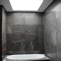 The Bathroom Was Finished In Black Tiles, Which Would Normally Darken The  Room, However The Skylight Really Brightens Up The Room.