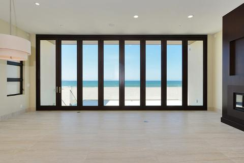 Beautiful ocean view through large bi-fold patio doors